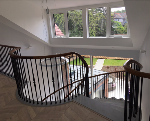 Landing area, curved Walnut handrail section with steel balustrade