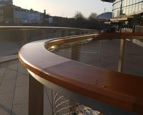 Oak handrail in sunshine