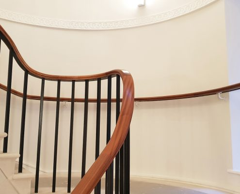 Rising timber handrail section with Black square steel spindles