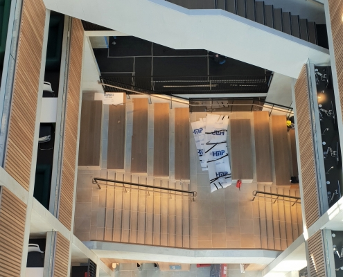 Atrium staircase in a university with Oak handrails