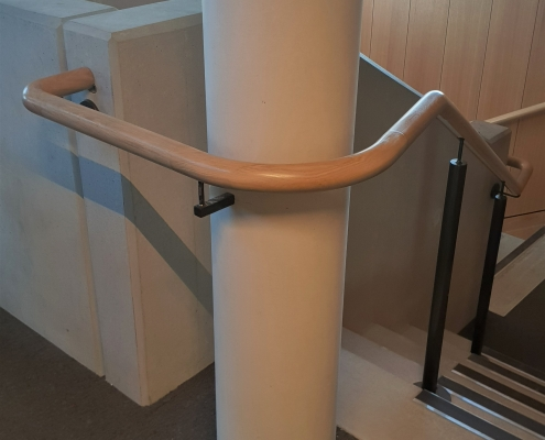 Continuous Oak mopstick curved handrail section