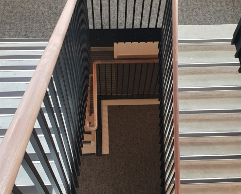 Walnut bespoke handrails with steel square spindles finished Black