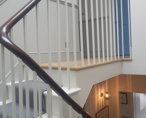 Mahogany timber handrail with square profile spindles to treads