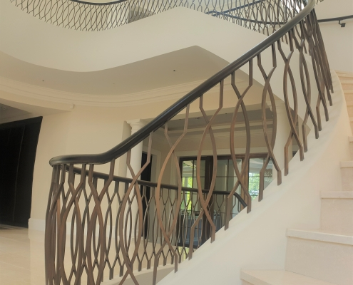 Bronze balustrade to Black timber handrail on curved staircase