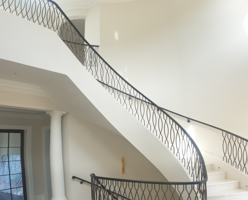 Curved staircase with Black timber handrail & steel bronze finished balustrade