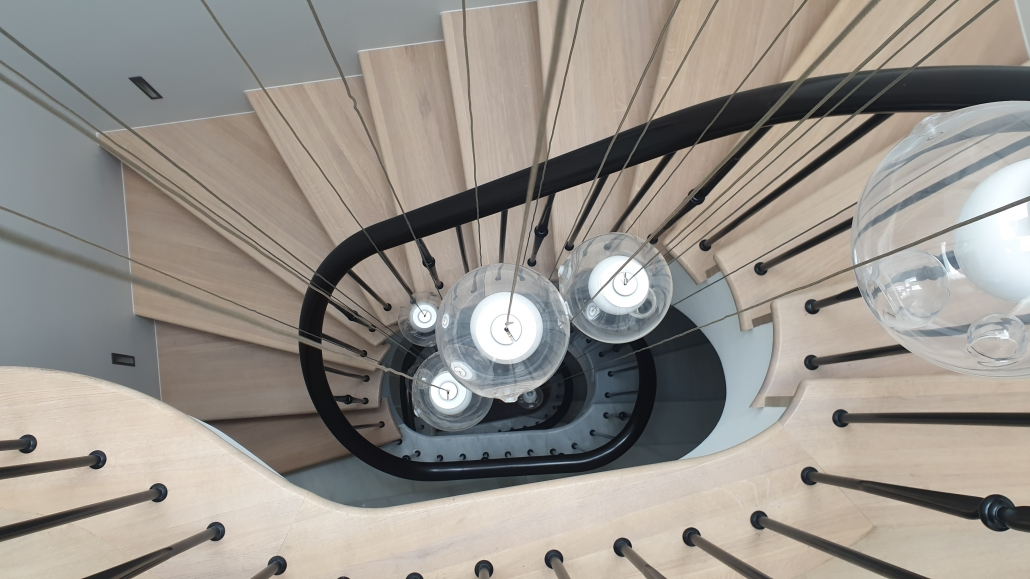Curved handrail finished Black with helical sections and floating light fittings
