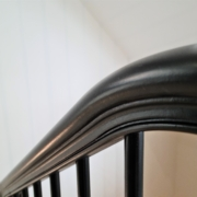 Bespoke curved handrail in Dark Black with matching coloured rounded spindles