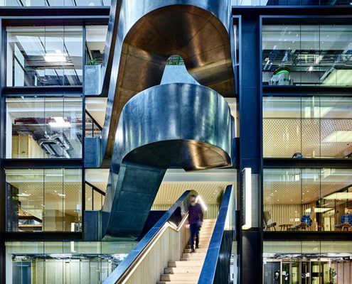 Curved staircases @ Google with bespoke Oak handrails