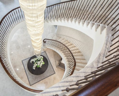 Hawk eye view of continuous Walnut handrail and steel balustrade