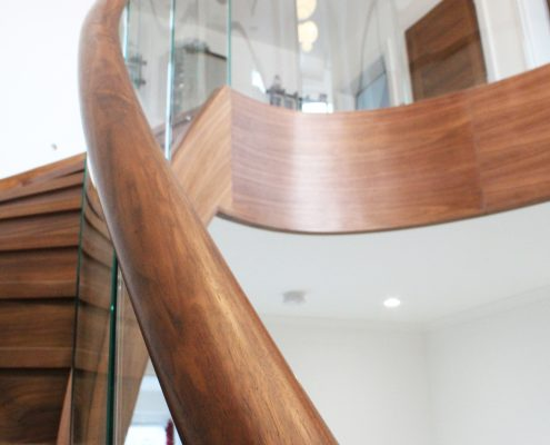 Rising helical Black walnut handrail with glass balustrade