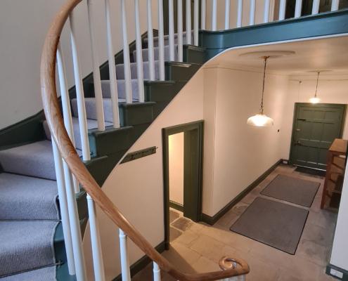 Curved oak rising handrails