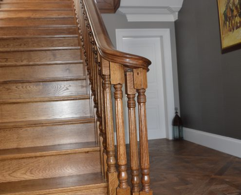 Wreathing handrail on concrete staircase then oak cladded