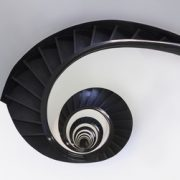 Spiral staircase with helical skirting boards, Black handrail