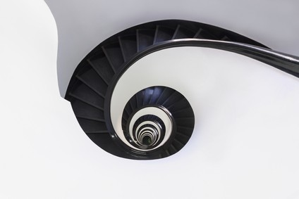 Spiral staircase in an old building with continuous sweeping handrail