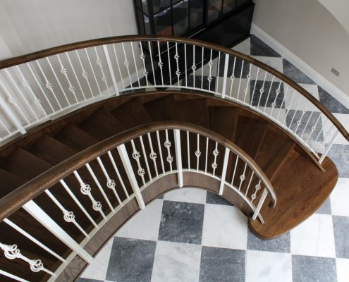 Curved staircase, bespoke handrail to match stair treads, complete with steel White balustrade