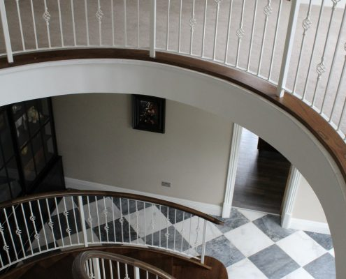 Helical handrail colour to match stair treads complete with steel White balustrade