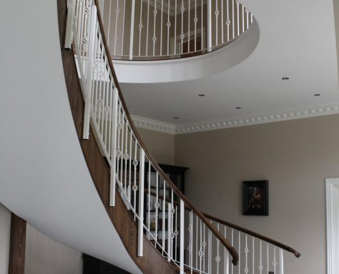 Helical handrail with core rail to underside of handrail to allow fixing of balustrade