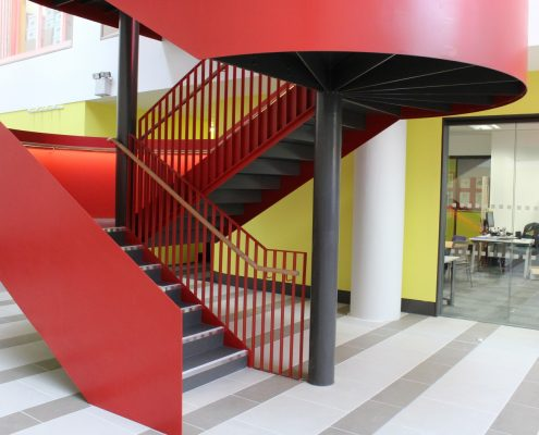 Oak handrail to staircase at a 6th form College