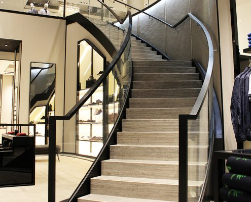 Tulipwood handrails with a stained Black finish either side of the glass balustrade
