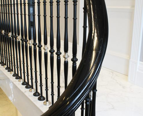 Wreathing section of stained finished handrail with steel spindles