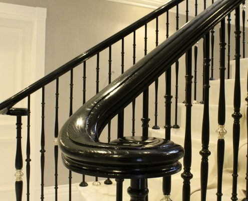 Stained Black handrail volute