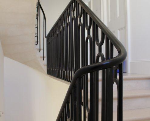 Polished oval handrail with bespoke steel balustrade