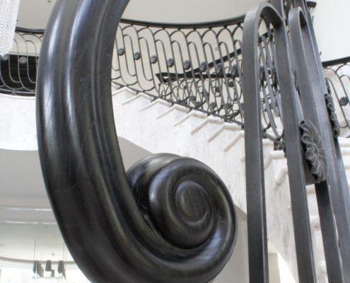 Handrail end scroll