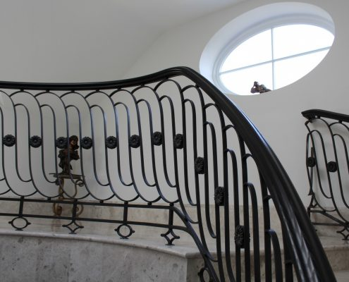 Helical section of bespoke handrail to stone staircase