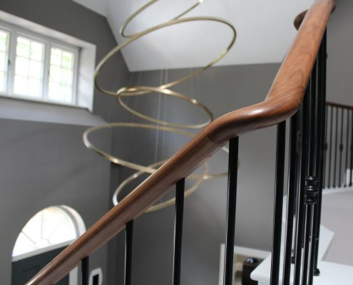 Cast iron spindles & dark Walnut handrail to landing