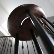 Walnut handrail volute with Black steel spindles