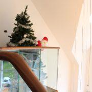 Walnut handrail and glass balustrade featuring Santa and Christmas tree