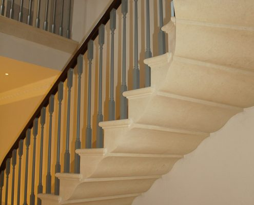 Stone staircase with Mahogany timber handrails and timber square profile spindles