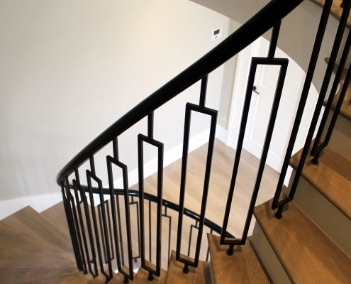 Sweeping handrail, timber handrail & steel balustrade both finished Piano Black