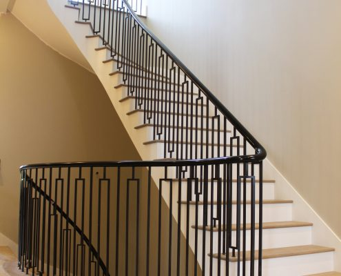 Little Boltons style steel balustrade with Sapele helical handrails both French polished Piano Black