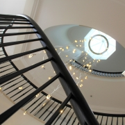 Underside of handrail with matching coloured rounded steel spindles