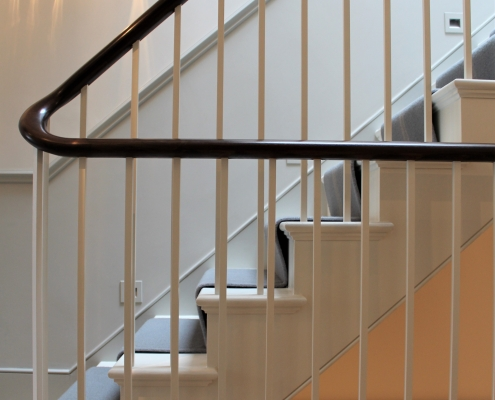 Timber square profile spindles in White to staircase and landing