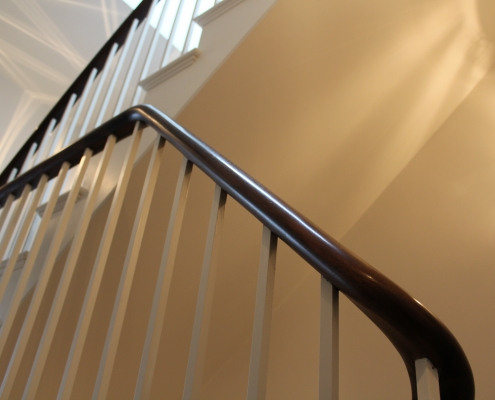Continuous Mahogany handrails with White square profile spindles