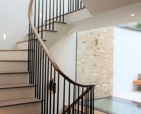 Continuous rising timber handrail with Black rounded spindles