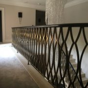 Brass plated balustrade and wooden handrail, straight and curved sections
