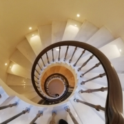 Stone spiral staircase with Mahogany rising (helical) handrail