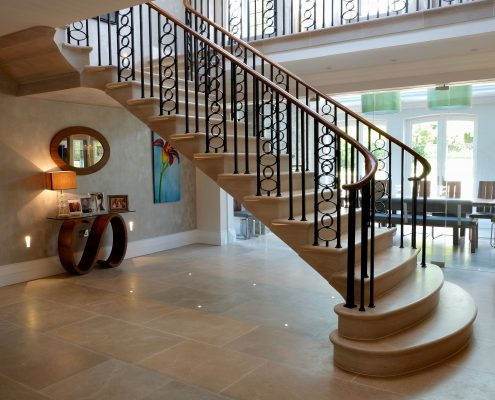 Walnut handrail with steel square spindles to cantoliva staircase