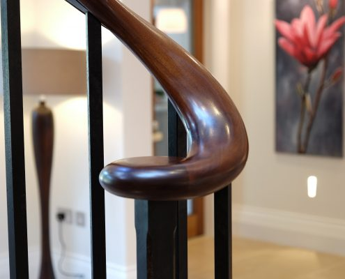 Black Walnut handrail scroll with square spindles
