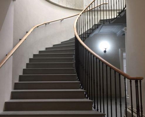 Bespoke handrail in Oak with wall brackets on wall side, steel spindles to one side
