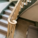 Oak volute (monkey tail) with curved handrail and wooden rounded spindles