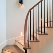 Steel Black tapered round spindles, LED wall light every couple of treads