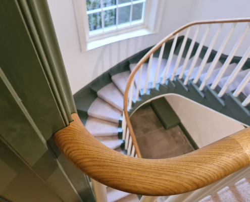 Curved timber handrail complete with White spindles