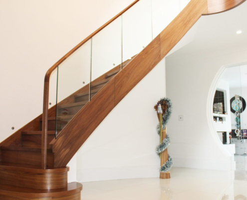Timber staircase with Walnut drop end handrail and glass balustrade