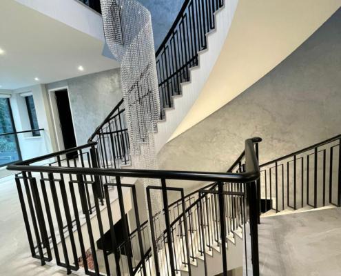 Landing handrail with welded balustrade