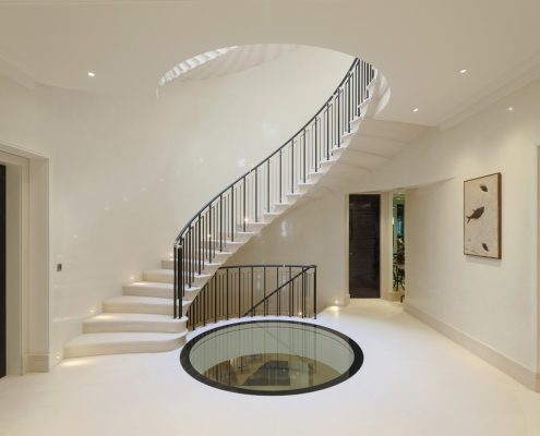 Bespoke handrail leather wrapped & steel balustrade colour matched on spiral staircase