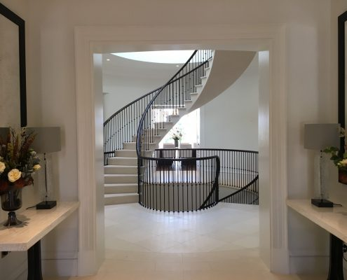 Landing view continuous handrail & spindles to stone spiral staircase